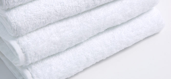 An image of folded Luxury Bath and Hand Towels cleaned by Queens Drive Laundry