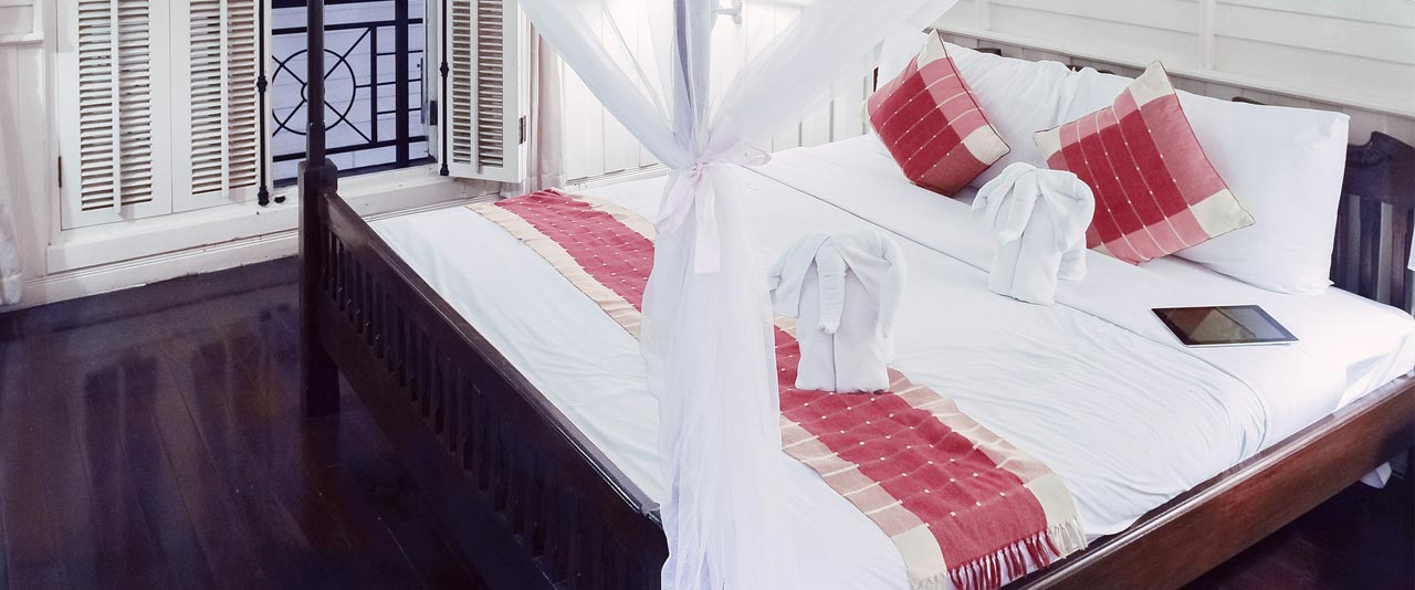 An image showing clean hotel linens on a bed