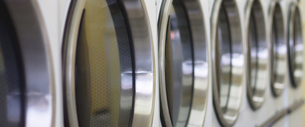 An image of the large Launderette Machines at Queens Drive Laundry