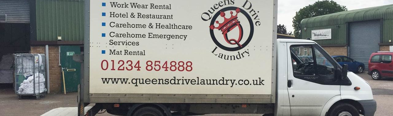 An image of a fully livered Queens Drive Laundry vehicle.