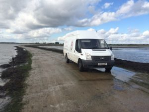 An image showing a Queens Drive Laundry van driving to Osea Island