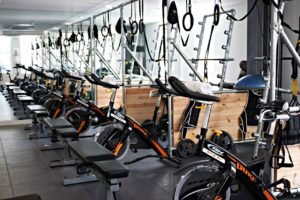 An image showing exercise bikes in a gym where people use a laundry service