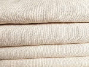 An image of a pile of linen blankets