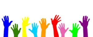 An image of hands reaching out to help others.