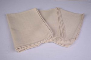 An image of three heavy duty oven cloths, available to purchase or hire from Queens Drive Laundry.