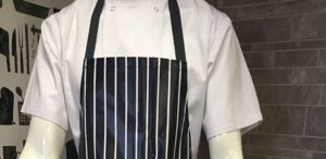 An image of a traditional butchers striped apron, available to hire or purchase from Queens Drive Laundry.