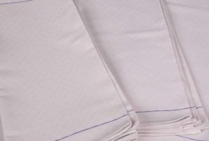 An image of multiple waiter cloths that are neatly folded.