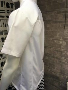 An image of a white chef jacket with a mesh back.